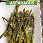 Asparagus spears topped with lemon zest and parmesan cheese laying on a white platter with title graphic across the top