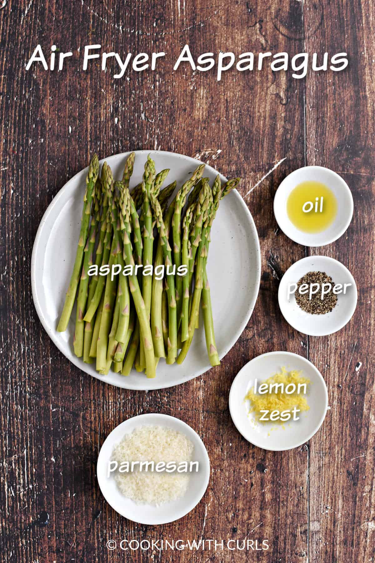 Asparagus spears, oil, pepper, lemon zest, and parmesan cheese in white bowls.