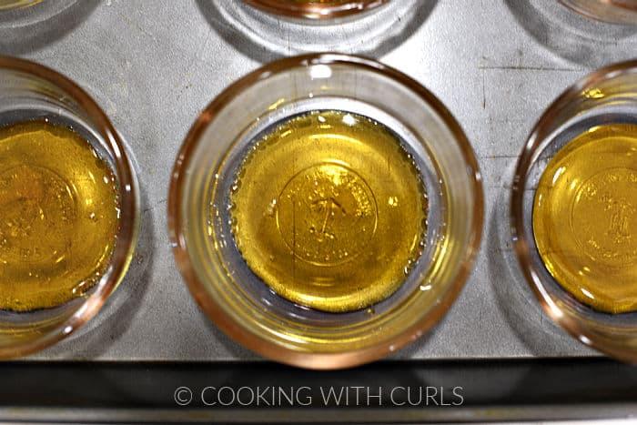 Caramelized sugar divided among 6 glass custard cups.