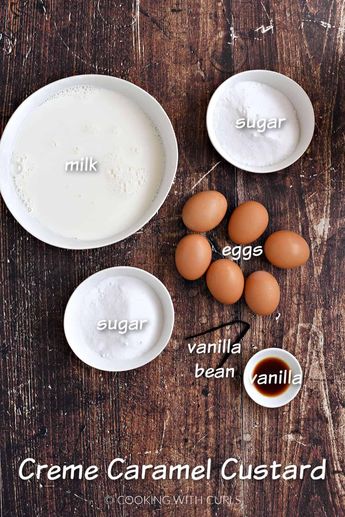 Milk, eggs, sugar, vanilla extract and vanilla bean to make caramel custard.