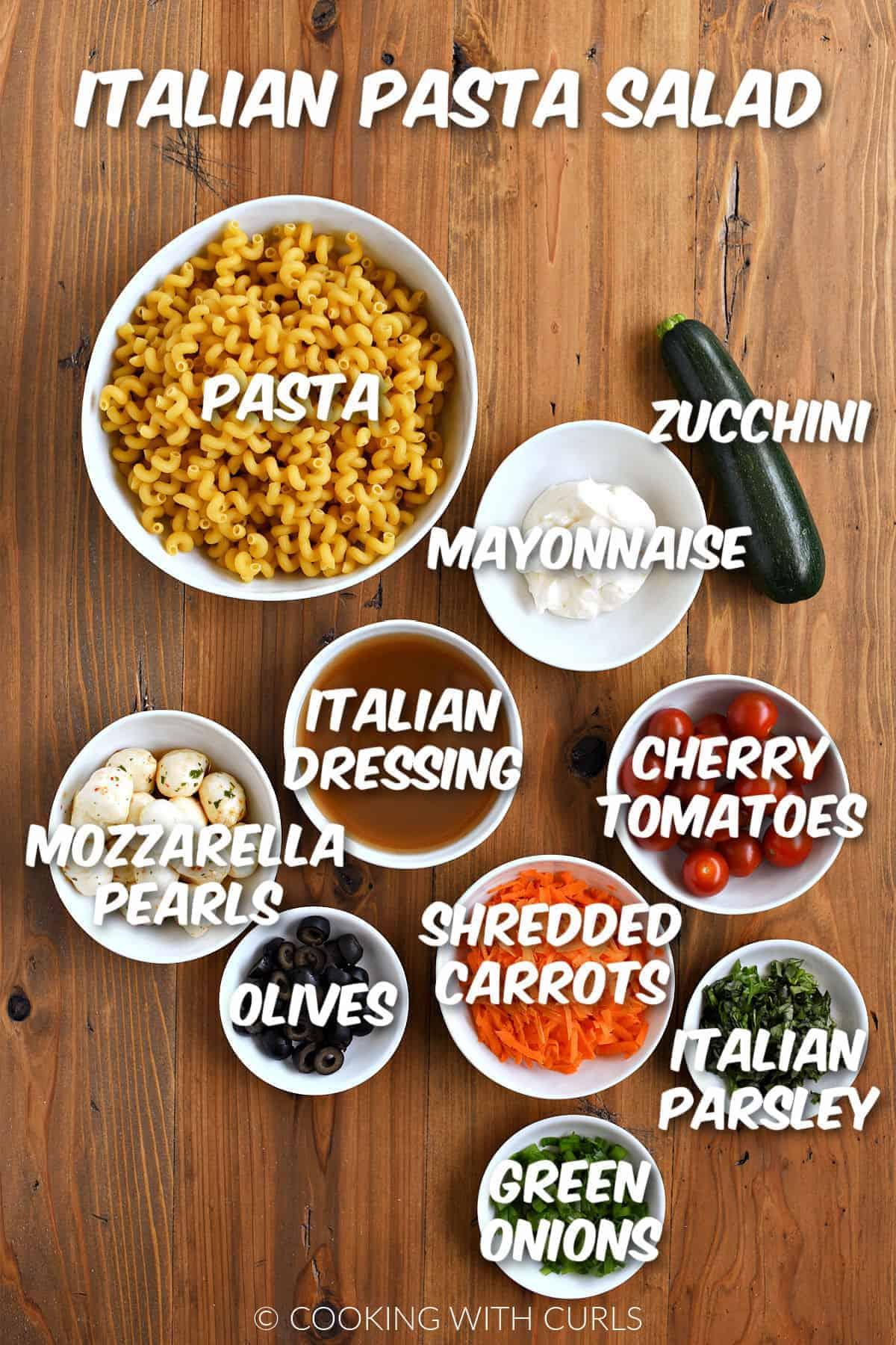 Italian Pasta Salad ingredients in white bowls.