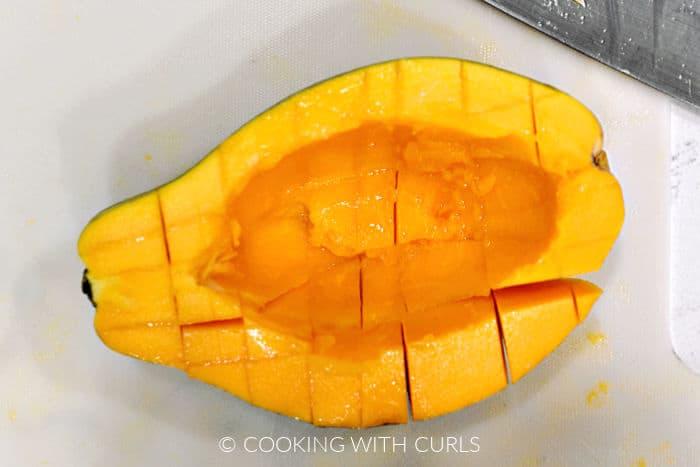 Half of a fresh papaya sliced into cubes.