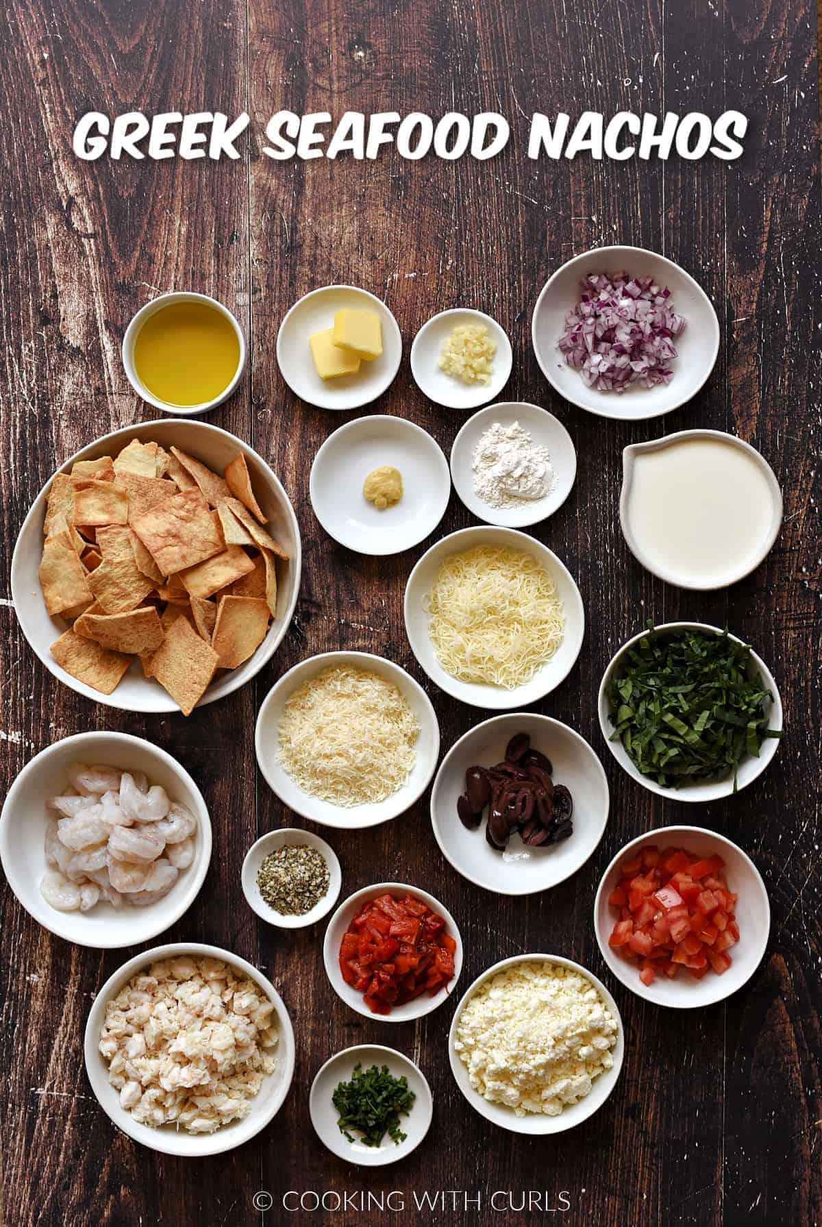 Ingredients to make Greek seafood nachos in small bowls.