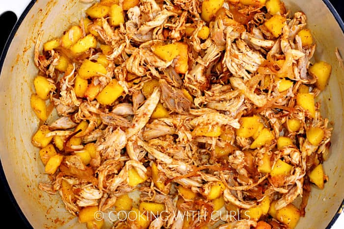 Peaches, chicken, spices, and caramelized onions in a large skillet.