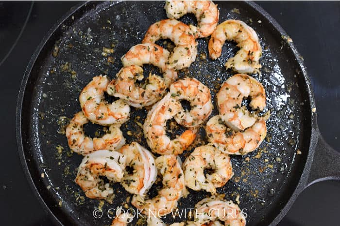 Seasoned shrimp cooked on a cast iron griddle.