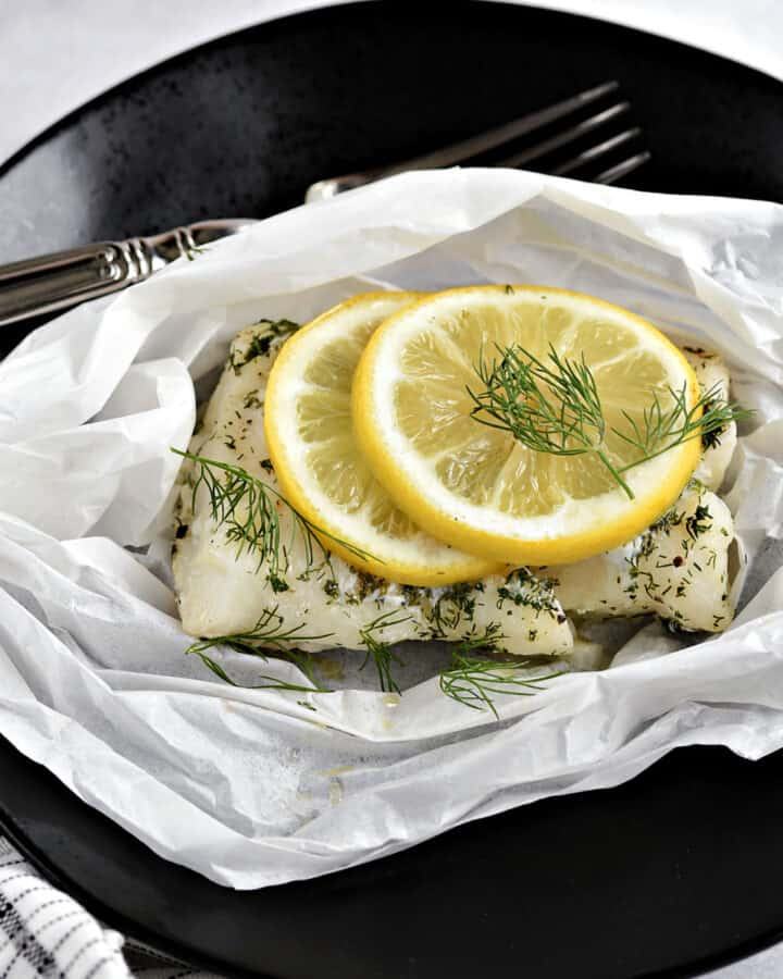 Baked Lemon-Dill Cod in Parchment Paper.