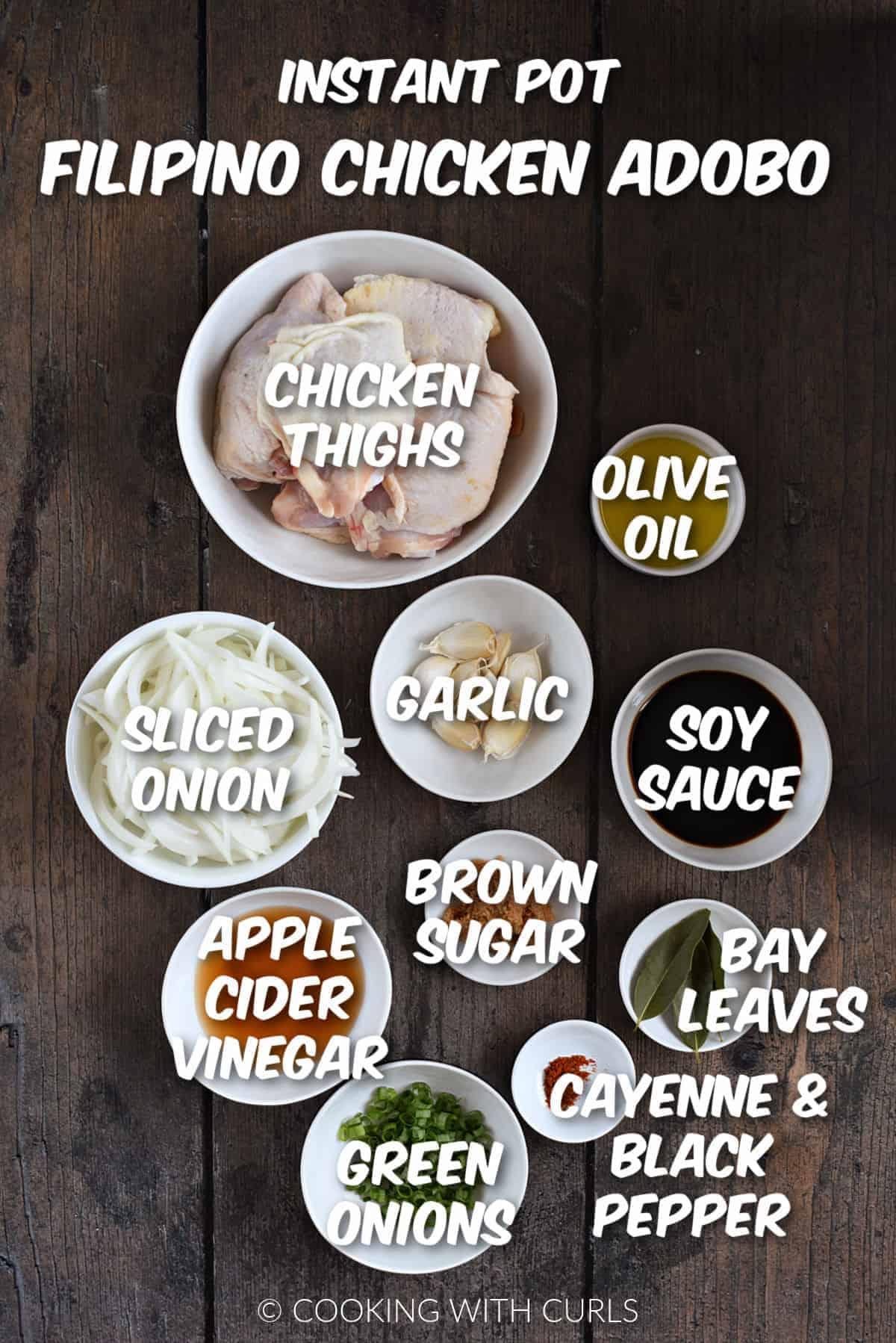 Ingredients to make instant pot filipino chicken adobo in white bowls.