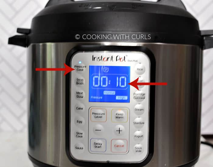 Instant Pot display set to 10 minutes on HIGH pressure.