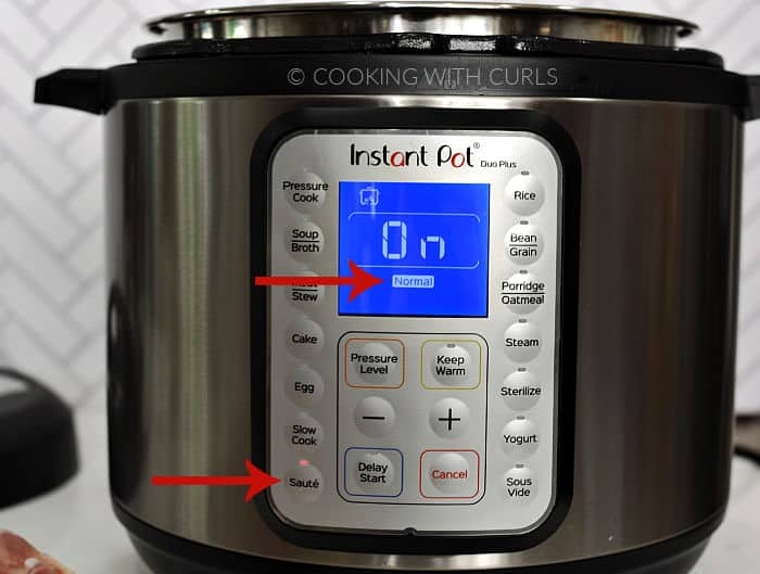 Instant Pot set to Saute - Normal with red arrows pointing to the buttons.
