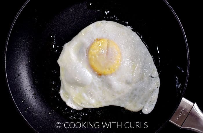 A fried egg in a small skillet.