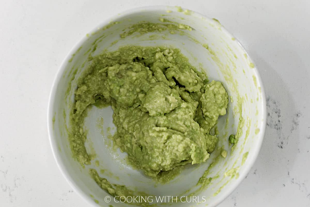 Mashed avocado in a small bowl.