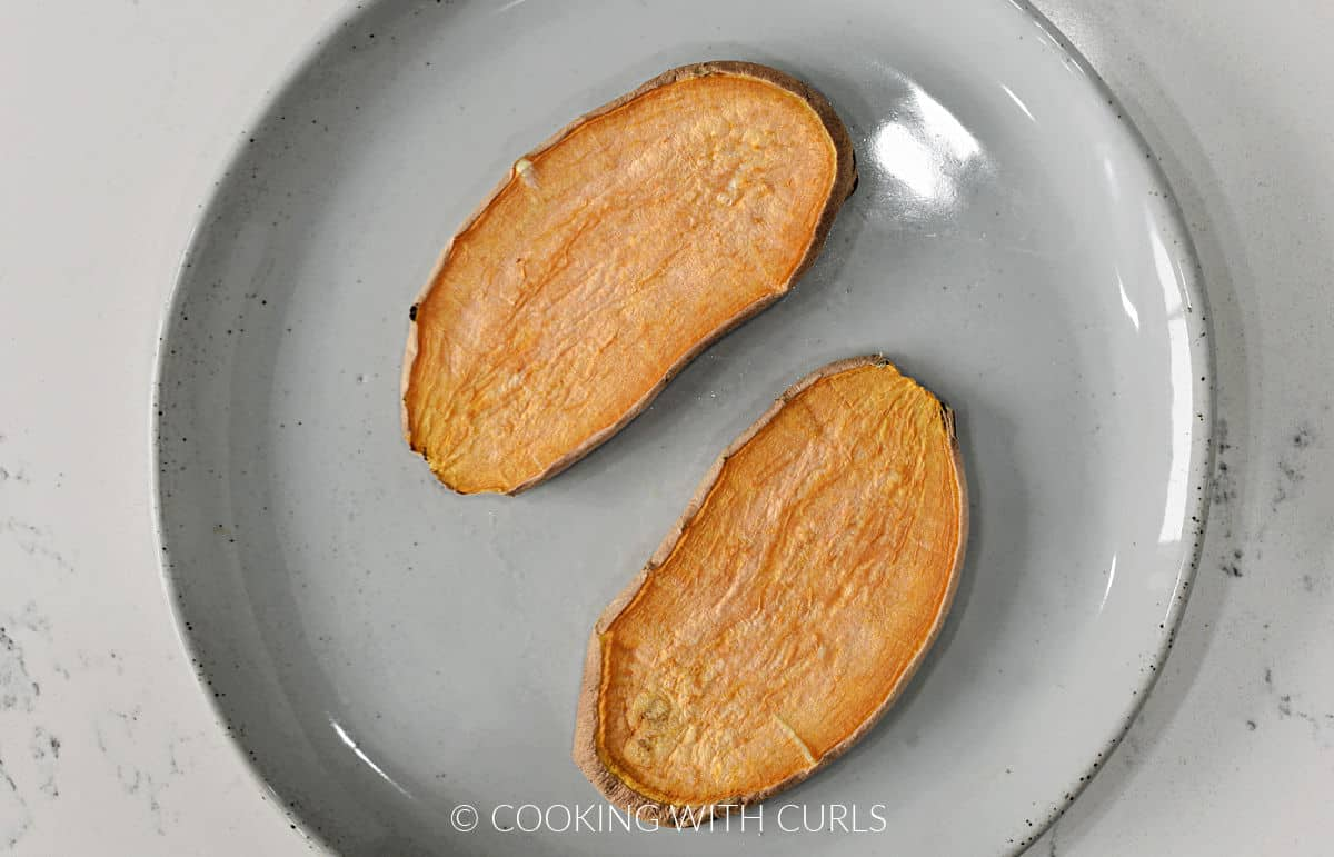 Two slices of sweet potato toast on a small plate.