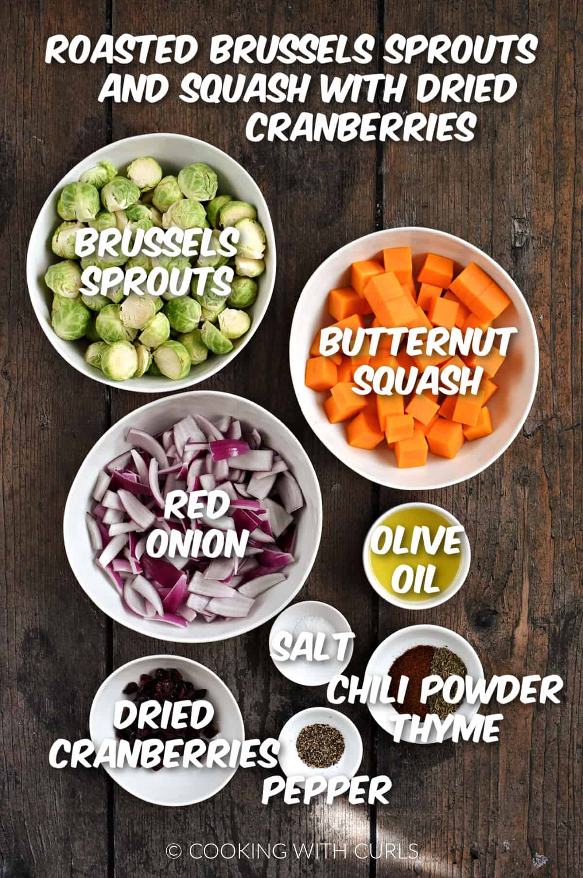 Brussels sprouts, butternut squash, onion, oil, seasonings, and dried cranberries in bowls.
