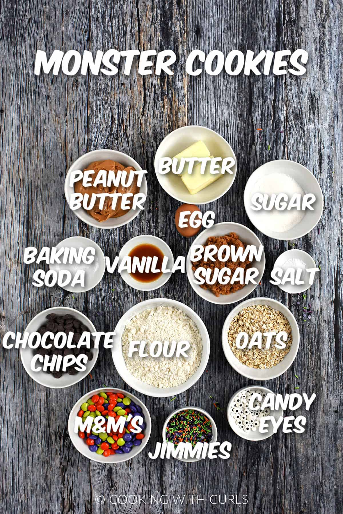 Ingredients to make Monster Cookies in small bowls.