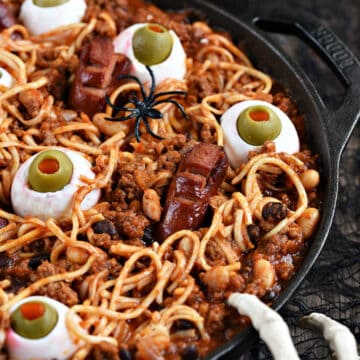 Spooky Halloween Chili with noodles, beans, egg eyes, and hot dog fingers and toes.